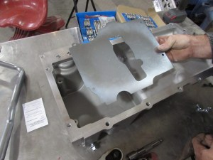 32. Another added feature of the Holley pans is the oil trap. This stamped-steel plate helps trap oil in the sump. The pan comes with the bolts, don't forget the threadlocker.
