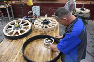 At this point, Jonathan is ready to cut the felloes to the final outer diameter. In order to do this, he must measure the inside diameter of the steel rim. The idea is to build the wooden felloe to be about 1/8-inch too large for proper fitment.