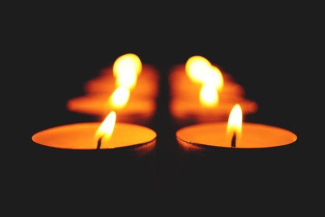 close up of illuminated candle against black background