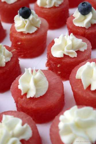 Stabilized Mascarpone Whipped Cream on watermelon: This stabilized whipped cream is my all-time favorite! It's light and airy - perfect to top cupcakes or ice cream, dip fruit in, or just eat by the spoonful! | stressbaking.com