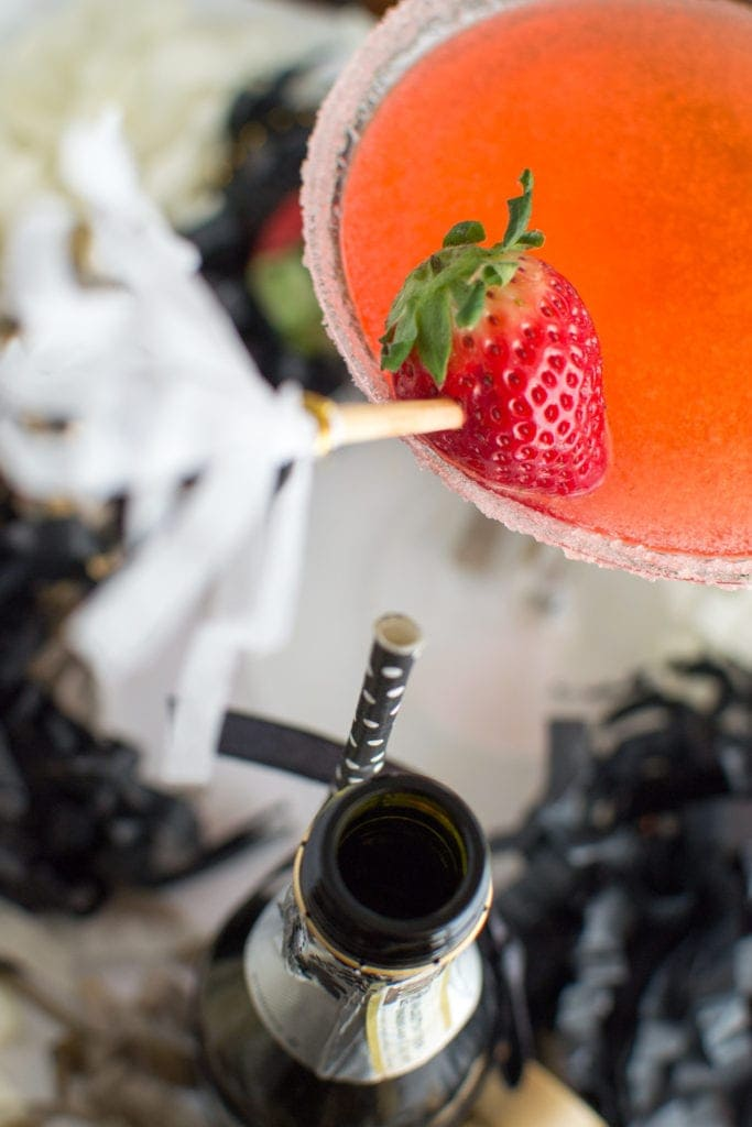Sparkling Strawberry Martini: Muddled strawberries, simple syrup and vodka come together for a slightly sweet and smooth fruit martini. A champagne float contribute just the right amount of festive bubbles! | hungerthirstplay.com
