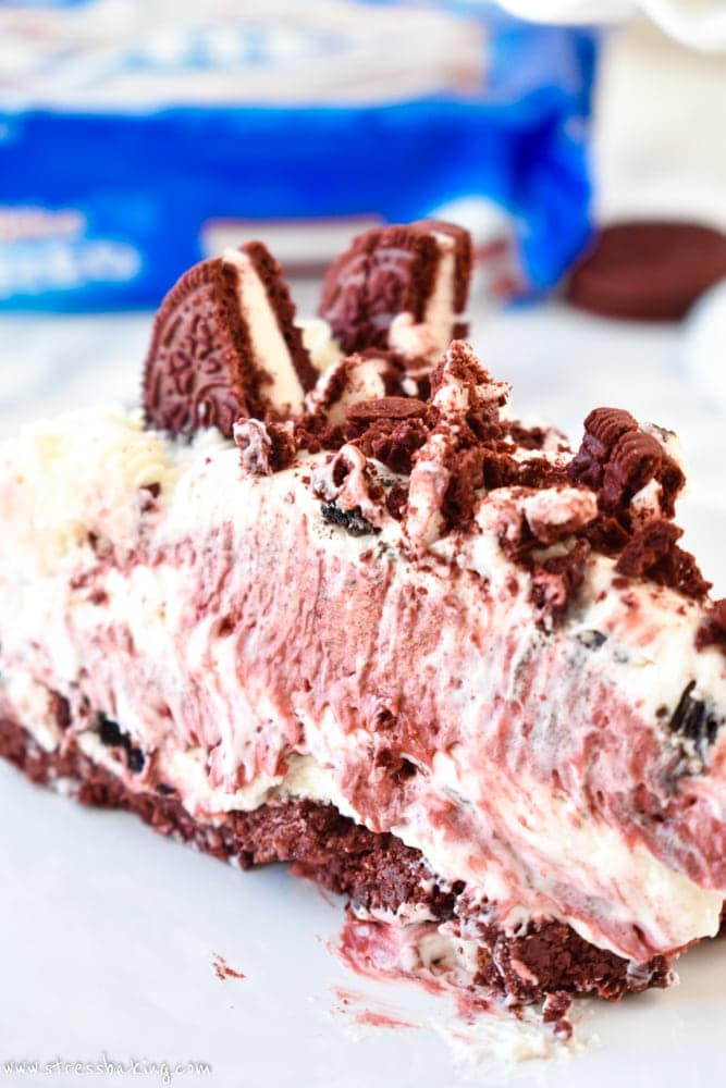 Red Velvet Oreo No-Bake Cheesecake: Supremely rich and creamy cheesecake filled with red velvet and Oreo flavors atop a Red Velvet Oreo crust. No baking required!  stressbaking.com #redvelvet #cheesecake #oreo #nobake #dessert