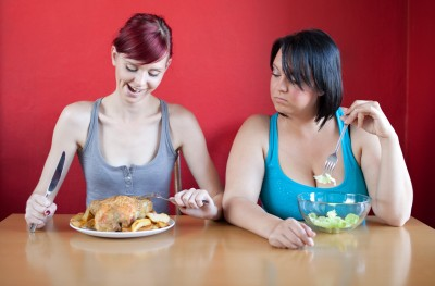 thin person eats, while heavy woman diets