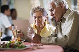 Older couple sharing a meal at a restaurant