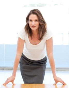 confident woman leaning forward