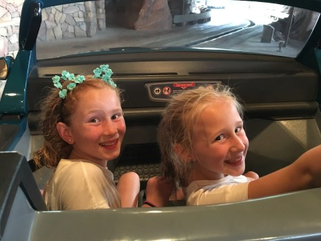audrey and ava on cars ride