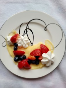Pastry cream topped with berries and meringue cookies