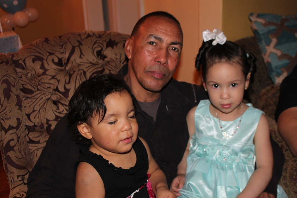 my daddy with my baby girl(in black) and little cousin