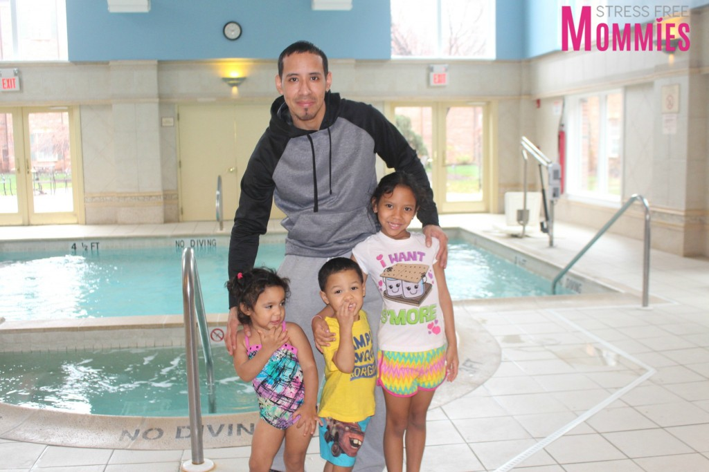 dad with kids at the pool