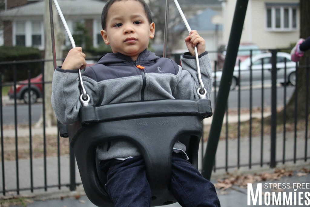 baby boy on swing