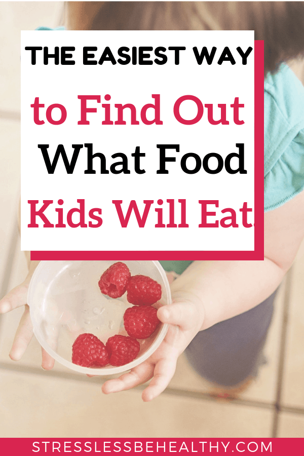 toddler holding bowl of raspberries, to show that it's not that hard to find out what food kids will eat