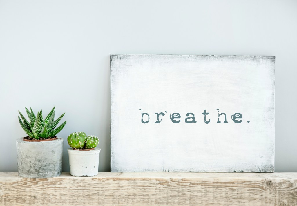 motivational poster quote BREATHE. scandinavian or american style room interior.
