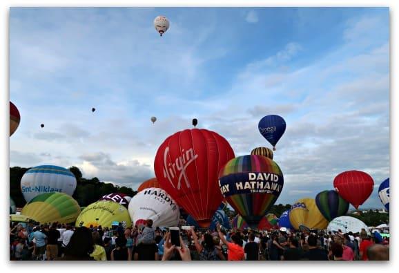 The crowds watch the balloons taking off at Bristol International Balloon Fiesta