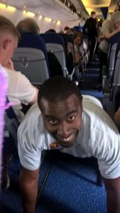 Man named Nolan performing plank on an airplane