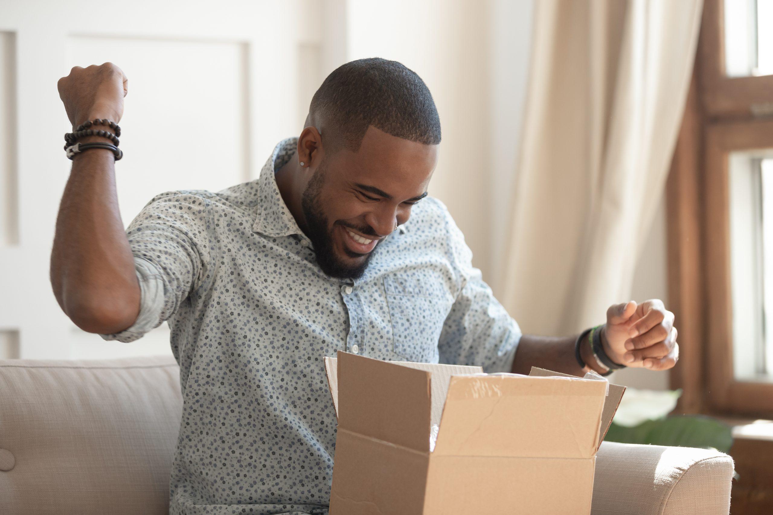 A happy man receiving his parcel