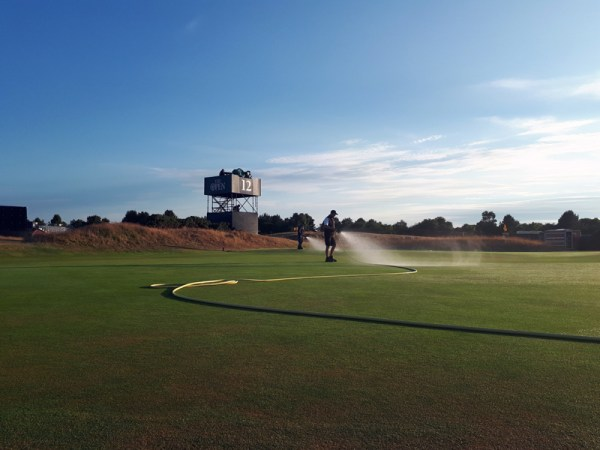 The Carnoustie Golf Links team hand watering the course. Image credit Craig Bo