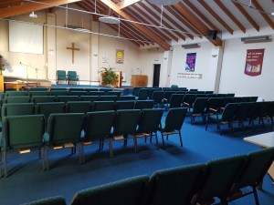 A small church. Chairs are laid out but the room is empty.
