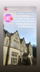 "An Instagram post. The image is of Hawkwood, a country house. The imposing house is in the gothic style, with plants creeping up its aged but well-presented facade. Its image is captured before a blue sky. Above is the text ""A week of making art but now over and out. Thank you so much @strikealightfestival & @hawkwood_cft"""