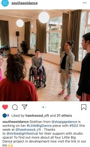 "A screenshot of an Instagram post. The picture is of five people in a rehearsal space. On person is in a wheelchair, the others stand. Below is the caption ""southeastdance: Siobhan from @stopgapdance is working on her #LittleBigDance piece with #SG2 this week at @hawkwood_cft. Thanks to @strikealightfestival for their support with studio space! To find out more about all four Little Big Dance project in development now visit the link in our bio (raised hands emoji)""."