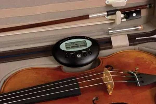 violin in case with hygrometer
