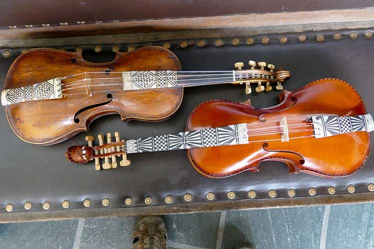 An old Hardanger fiddle from about 1750 and a modern-day copy.