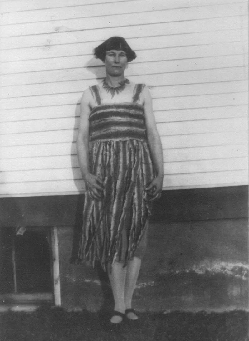 Katherine McHale Slaughterback, also known as Rattlesnake Kate, posing in her rattlesnake dress, 1926