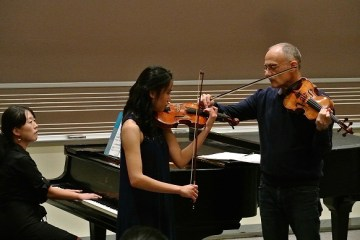 violin student and teacher with pianist