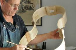 Luthier working on a cello frame