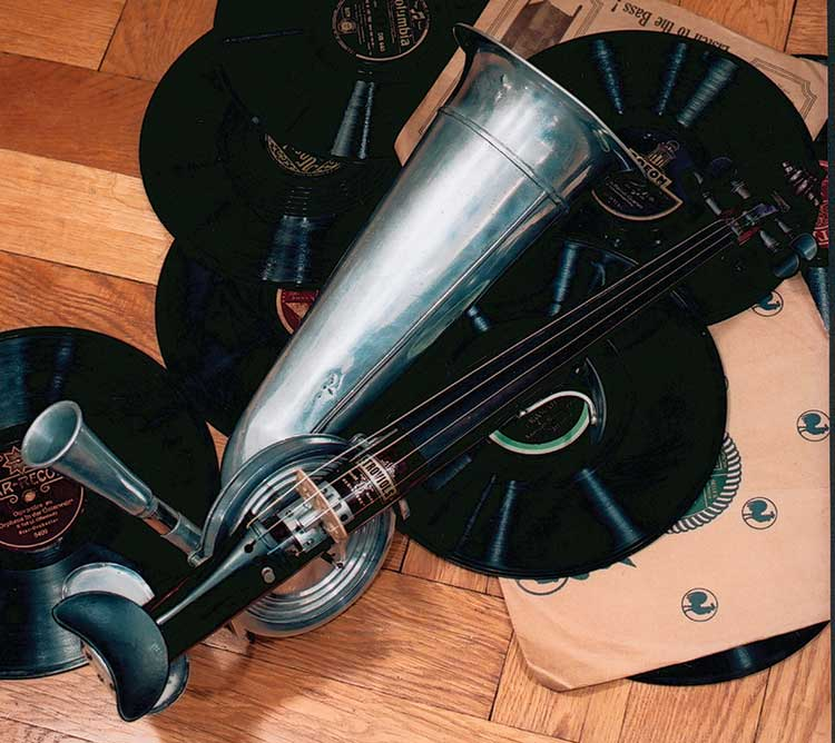 Strohviol on the floor with records