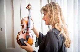 """Violinist Francesca Dego holding Paganini's violin """"Il Cannone"""""""