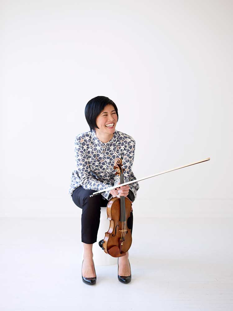Violinist Jennifer Koh smiling with violin