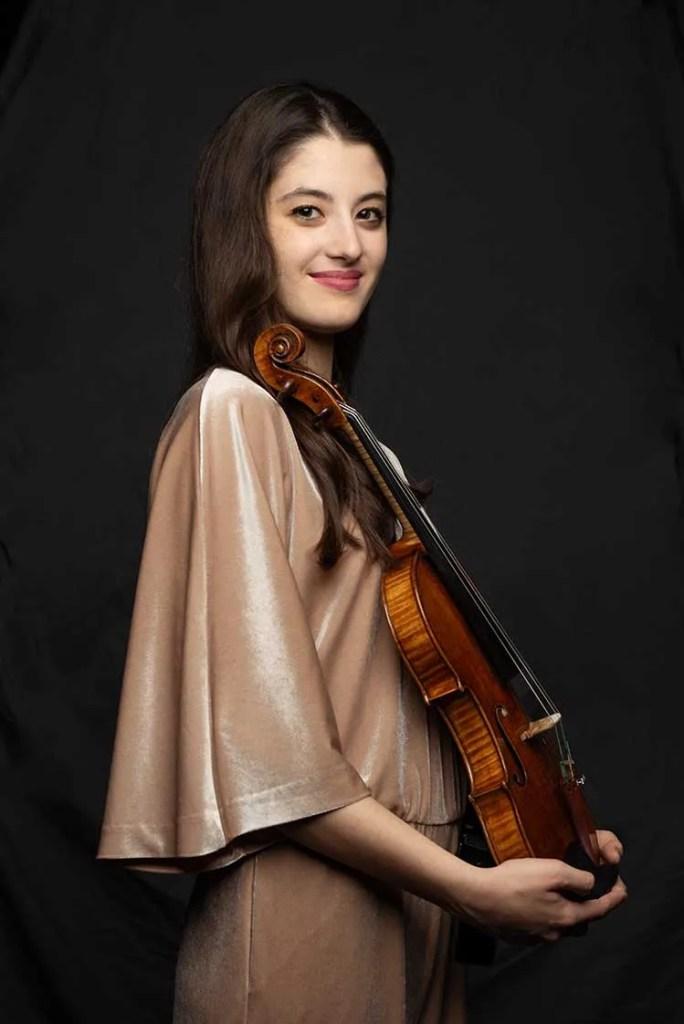 Maria Duenas holding a violin