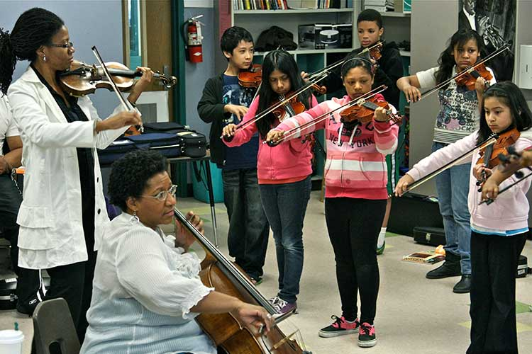 The Marian Anderson String Quartet at a University of Washington World Series workshop for the students at the Seattle Music Partners