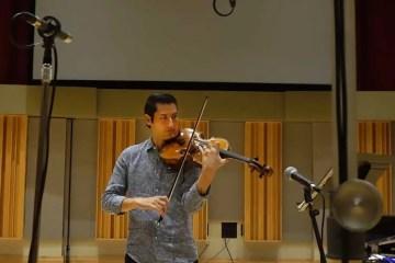 Violist Masumi Rostad recording on his instrument