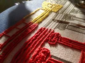 British Museum Tea-towel. Wool on linen tea-towel. Renata Bursten.
