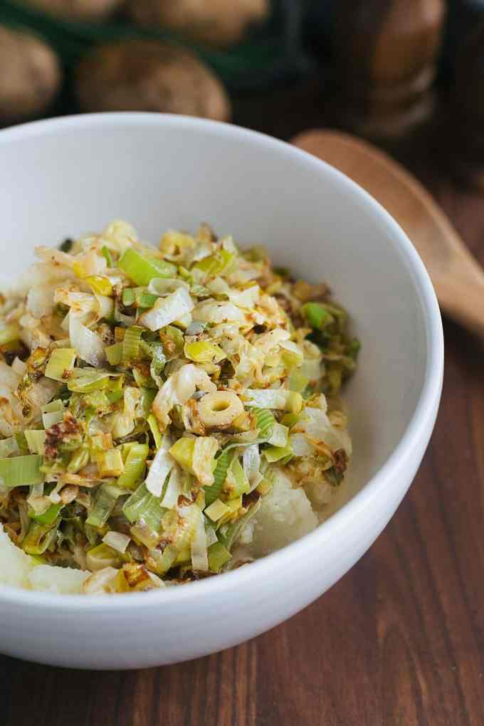 sauteed cabbage and leeks with mashed russet potatoes in a bowl