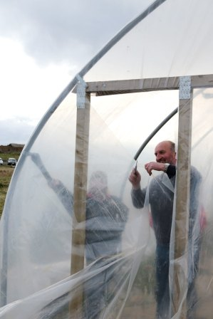Cutting plastic at polytunnel ends