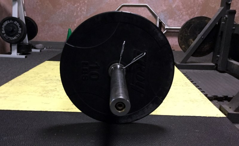 Height from floor of Olympic bar with bumper plate.