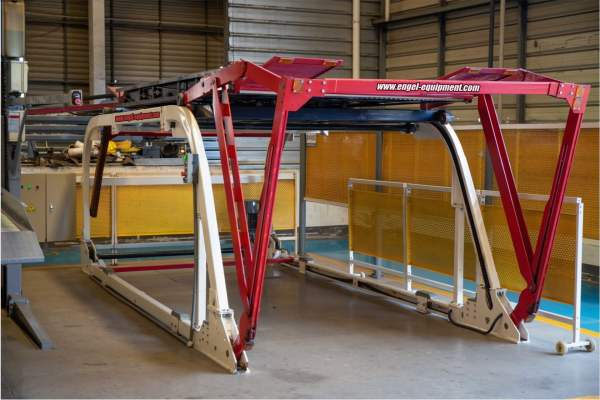 Red white and black car lift in a warehouse.