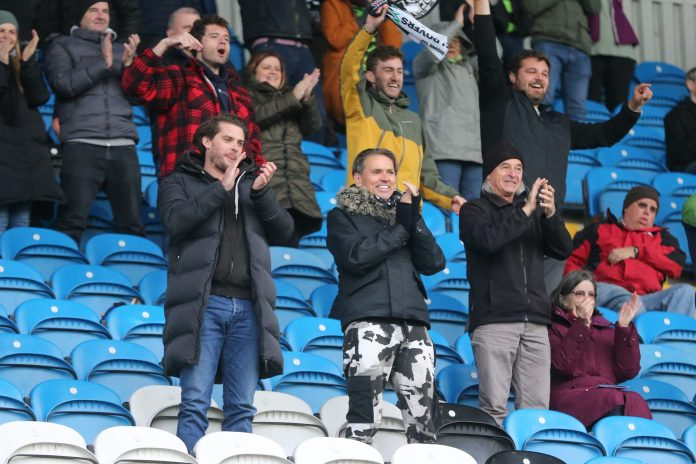 No ties: Forest Green chairman Dale Vince joins fans on the terraces