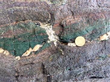 Brittle failure of an eclogitic block in a ductile blueschist matrix on Syros Island, Greece