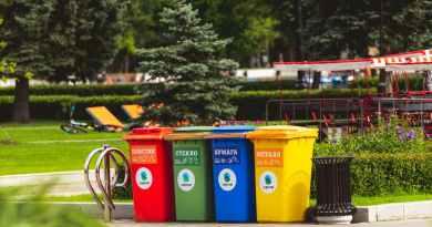 assorted color plastic trash bins