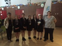 Something Sweet donating to Trish De Carteret from Les Bourgs Hospice with Deputy Head teacher Mrs Clark