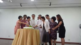 The Parish Pastoral Council members cutting the cake with Archbishop John Wong and Fr Cosmas Lee.