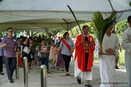 Several children and the churchgoers following Fr Cosmas Lee into the main church during the procession.