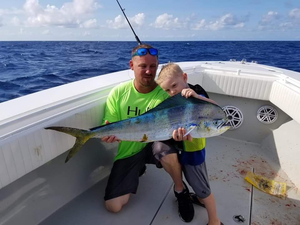 YOUNG-KID-CATHING-COLORFUL-MAHI