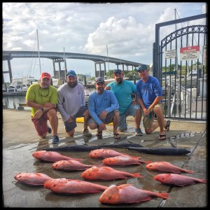 group-friends-showing-their-big-catch-freeport-marina