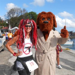 Brenda Silvia poses with McGruff the crime dog before the start of Sunday's race.