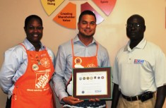 V.I. State Chair Beresford Edwards (right) presents Home Depot representatives, Hermeian Leon, human resources manager and Warren Cork, store manager, with a Seven Seals Award.