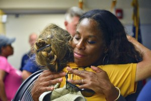 Delegate to Congress Stacey Plaskett embraces a Virgin Islander after the territory was hit by two category five hurricanes. (Photo from Plaskett's official website)